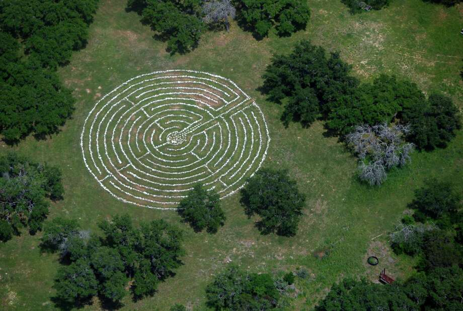The labyrinth at St. Thomas Episcopal Church is seen in this April 10, 2012 aerial photo. According to the website labyrinthlocator.om, the labyrinth was built in 2008 and is a reproduction of the 13th century labyrinth found in the Chartres Cathedral in France. Photo: William Luther, San Antonio Express-News / © 2012 WILLIAM LUTHER
