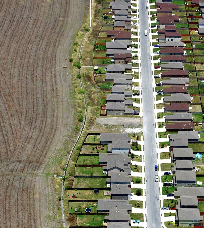 Farm land and subdivisions meet in this Wednesday Aug. 1, 2012 aerial image taken over San Antonio's west side. Photo: William Luther, San Antonio Express-News / © 2012 San Antonio Express-News