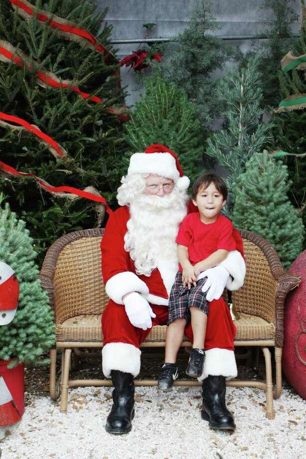 Santa Photos – Saturday, December 1, 2012 Milberger Landscaping and Nursery Photo: Express-News / SA Photo: Santa Photos – Saturday, December 1, 2012 Milberger Landscaping And Nursery Photo: Express-News / SA