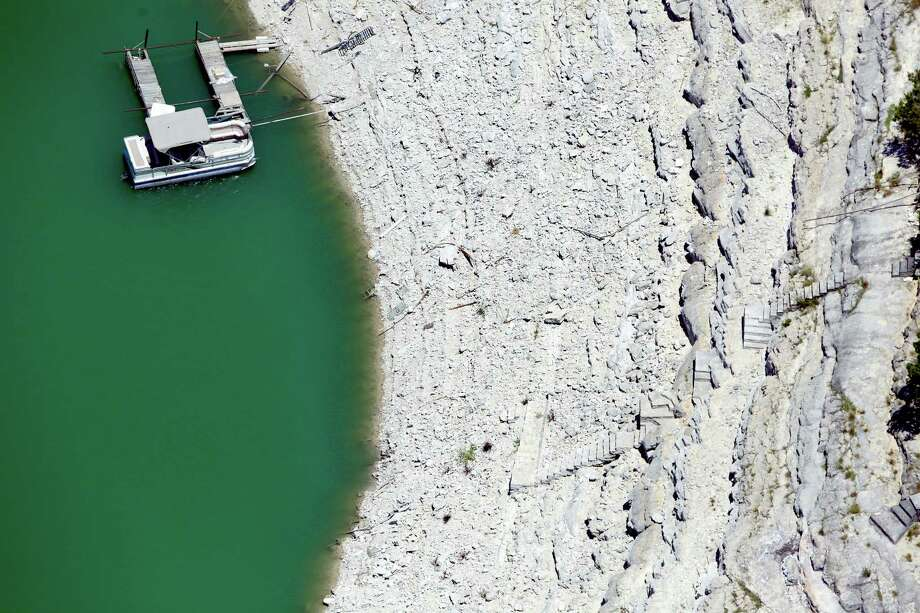 Medina Lake is seen in a Wednesday Aug. 1, 2012 aerial image. The Texas Water Development Board's website reported the lake was 59.39 feet low and was only 16.22 percent full. As of Dec. 7 the lake had dropped another 10 feet from this level to 69.66 feet low and only 10.61 percent full Photo: William Luther, San Antonio Express-News / © 2012 San Antonio Express-News