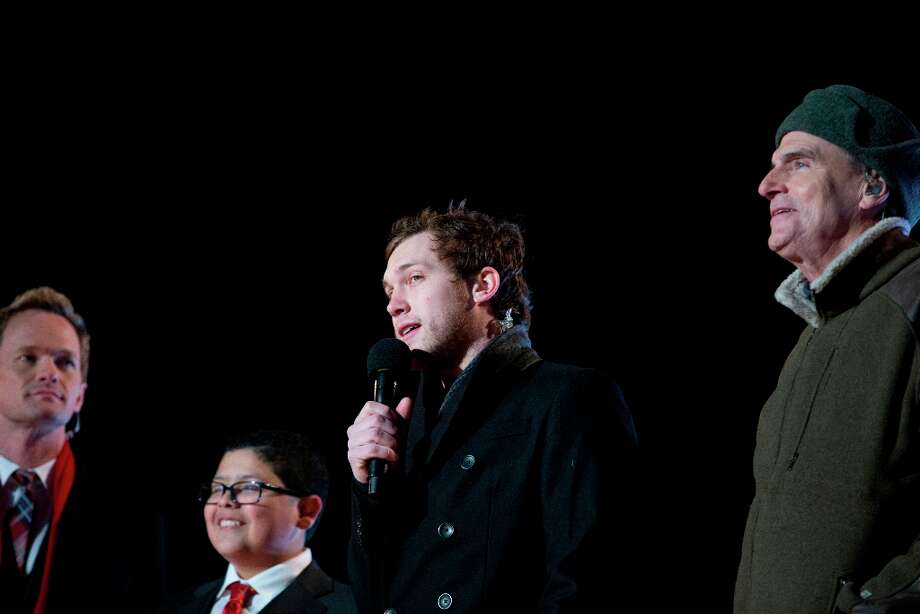 From left, actors actor Neil Patrick Harris, and Rico Rodriguez, American Idol season 11 winner Phillip Phillips, and singer James Taylor participate in the annual National Christmas Tree Lighting on the Ellipse, Thursday, Dec. 6, 2012, in Washington. This year's giant blue spruce is new, transplanted in October on the Ellipse, south of the White House.  (Carolyn Kaster / AP Photo) Photo: Carolyn Kaster, Associated Press / AP