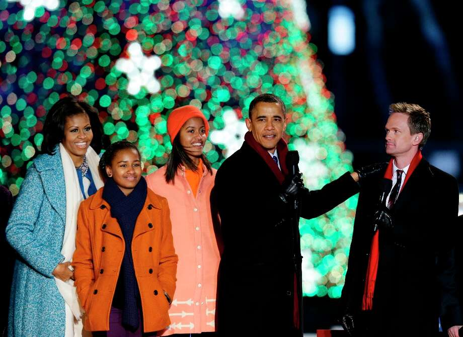 President Barack Obama, second from right, first lady Michelle Obama, left, Sasha Obama, second from left, Malia Obama, and host Neil Patrick Harris prepare to sing during the 90th annual National Christmas Tree Lighting ceremony on the Ellipse south of the White House, Thursday, Dec. 6, 2012, in Washington.  (Alex Brandon / AP photo) Photo: Alex Brandon, Associated Press / AP