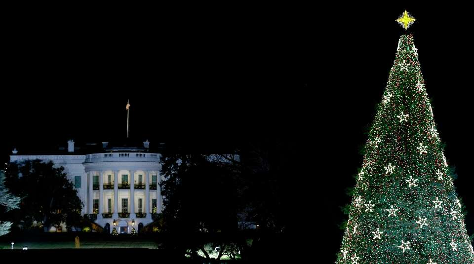 With the White House in the background, the National Christmas Tree is lit during the lighting cerem