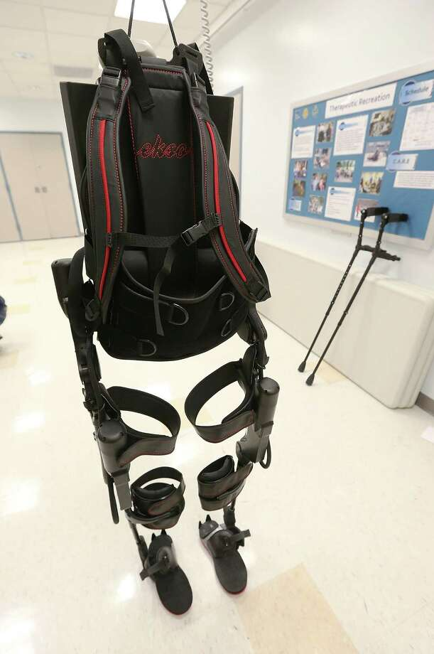 NEW YORK, NY - DECEMBER 06:  An exoskeleton device made by Ekso Bionics hangs suspended during a demonstration at the opening of the Rehabilitation Bionics Program at Mount Sinai Rehabilitation Center on December 6, 2012 in New York City. Woo is an architect who was paralyzed from the hips down during a construction accident and thought he would never walk again. The new strap-on exoskelton uses motors and sensors to physically move the legs. Photo: Mario Tama, Getty Images / 2012 Getty Images