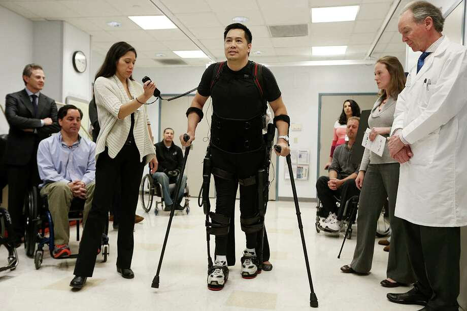 NEW YORK, NY - DECEMBER 06:  Forty three-year-old parapalegic Robert Woo walks with an exoskeleton device made by Ekso Bionics during a demonstration at the opening of the Rehabilitation Bionics Program at Mount Sinai Rehabilitation Center on December 6, 2012 in New York City. Woo is an architect who was paralyzed from the hips down during a construction accident and thought he would never walk again. The new strap-on exoskelton uses motors and sensors to physically move the legs. (Photo by Mario Tama/Getty Images) *** BESTPIX *** Photo: Mario Tama, Getty Images / 2012 Getty Images