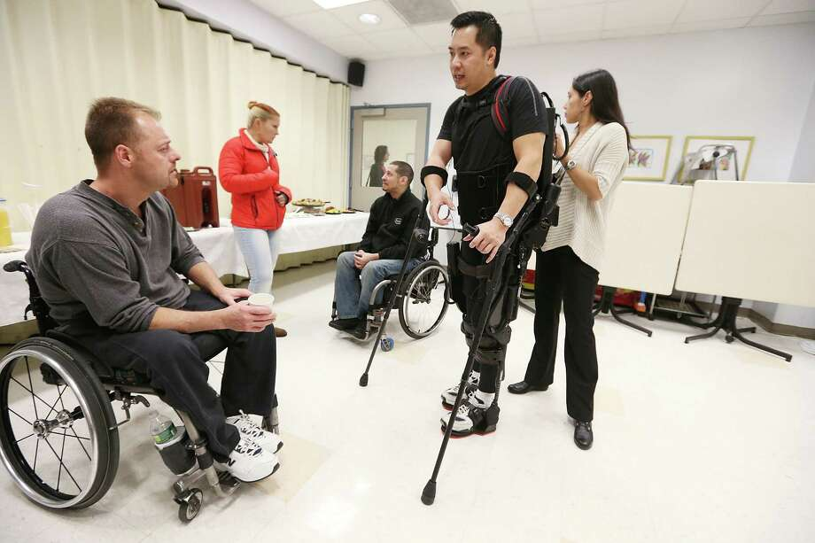 NEW YORK, NY - DECEMBER 06:  Forty three-year-old parapalegic Robert Woo walks with an exoskeleton device made by Ekso Bionics during a demonstration at the opening of the Rehabilitation Bionics Program at Mount Sinai Rehabilitation Center on December 6, 2012 in New York City. Woo is an architect who was paralyzed from the hips down during a construction accident and thought he would never walk again. The new strap-on exoskelton uses motors and sensors to physically move the legs. Photo: Mario Tama, Getty Images / 2012 Getty Images