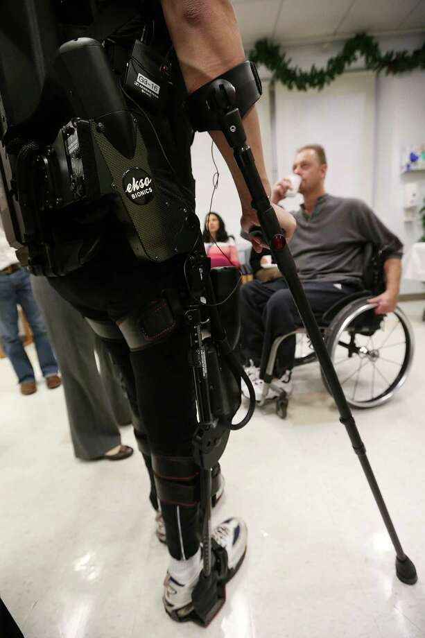 NEW YORK, NY - DECEMBER 06:  Forty three-year-old parapalegic Robert Woo stands while walking with an exoskeleton device made by Ekso Bionics during a demonstration at the opening of the Rehabilitation Bionics Program at Mount Sinai Rehabilitation Center on December 6, 2012 in New York City. Woo is an architect who was paralyzed from the hips down during a construction accident and thought he would never walk again. The new strap-on exoskelton uses motors and sensors to physically move the legs. Photo: Mario Tama, Getty Images / 2012 Getty Images