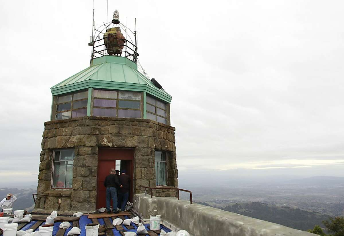 Volunteers arrive to prepare the historic beacon for its annual lighting ceremony on Dec. 7, 2012, on the summit at Mount Diablo State Park.