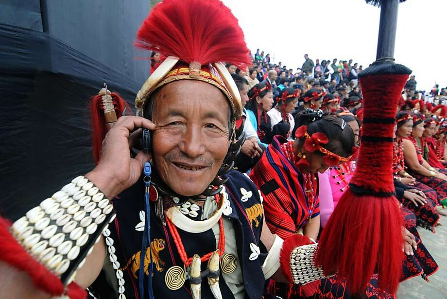 Just checking my voicemail: India's 16 indigenous Naga tribes, which were meeting in Kisama for the Hornbill Festival - a week-long celebration of Naga cultural heritage - still live in clans, hunt with spears, weave shawls and baskets, and raise pigs. But they have embraced some aspects of modern life. Photo: Biju Boro, AFP/Getty Images