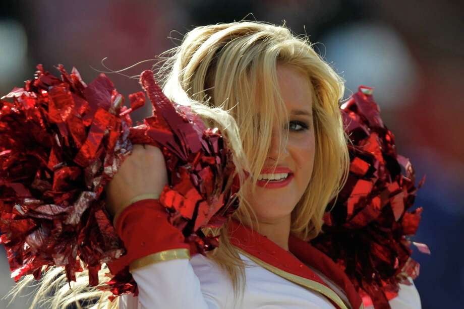 A Kansas City Chiefs cheerleader has added a little gold to the red and white.  Photo: Ed Zurga, Associated Press / FR34145 AP