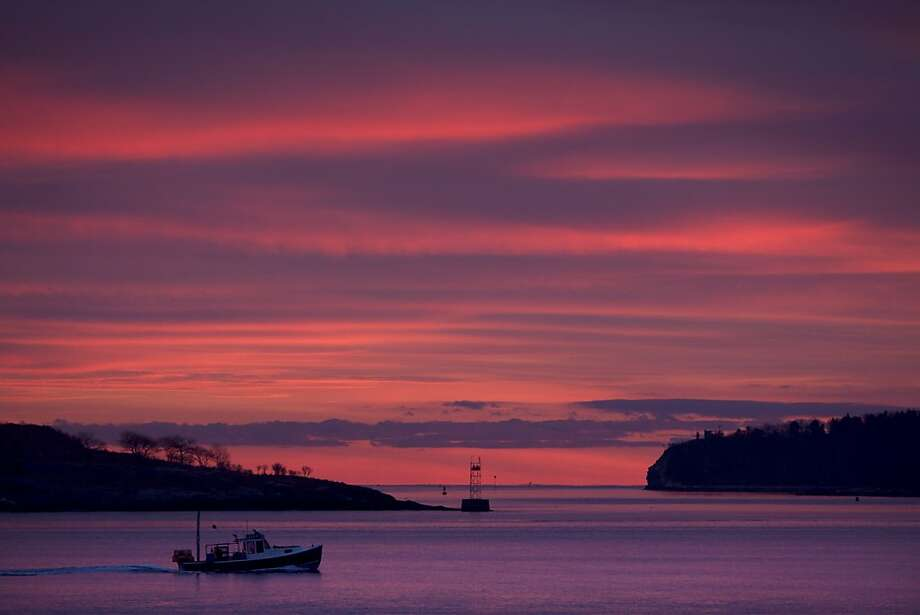 Red sky in the morning, sailors take warning - except for this lobster boat off South Portland, Maine, which chose to ignore the sign of a coming storm. Photo: Robert F. Bukaty, Associated Press