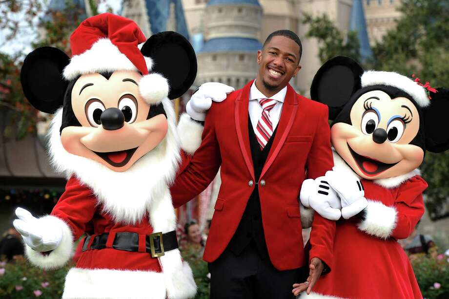 Nick Cannon's suit is like Santa, but with more swag.  Photo: Handout, Disney Via Getty Images / 2012 Disney