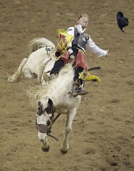 Playing with Doll: Bronc rider Wes Stevenson struggles to stay aboard Freckled Doll in the ba