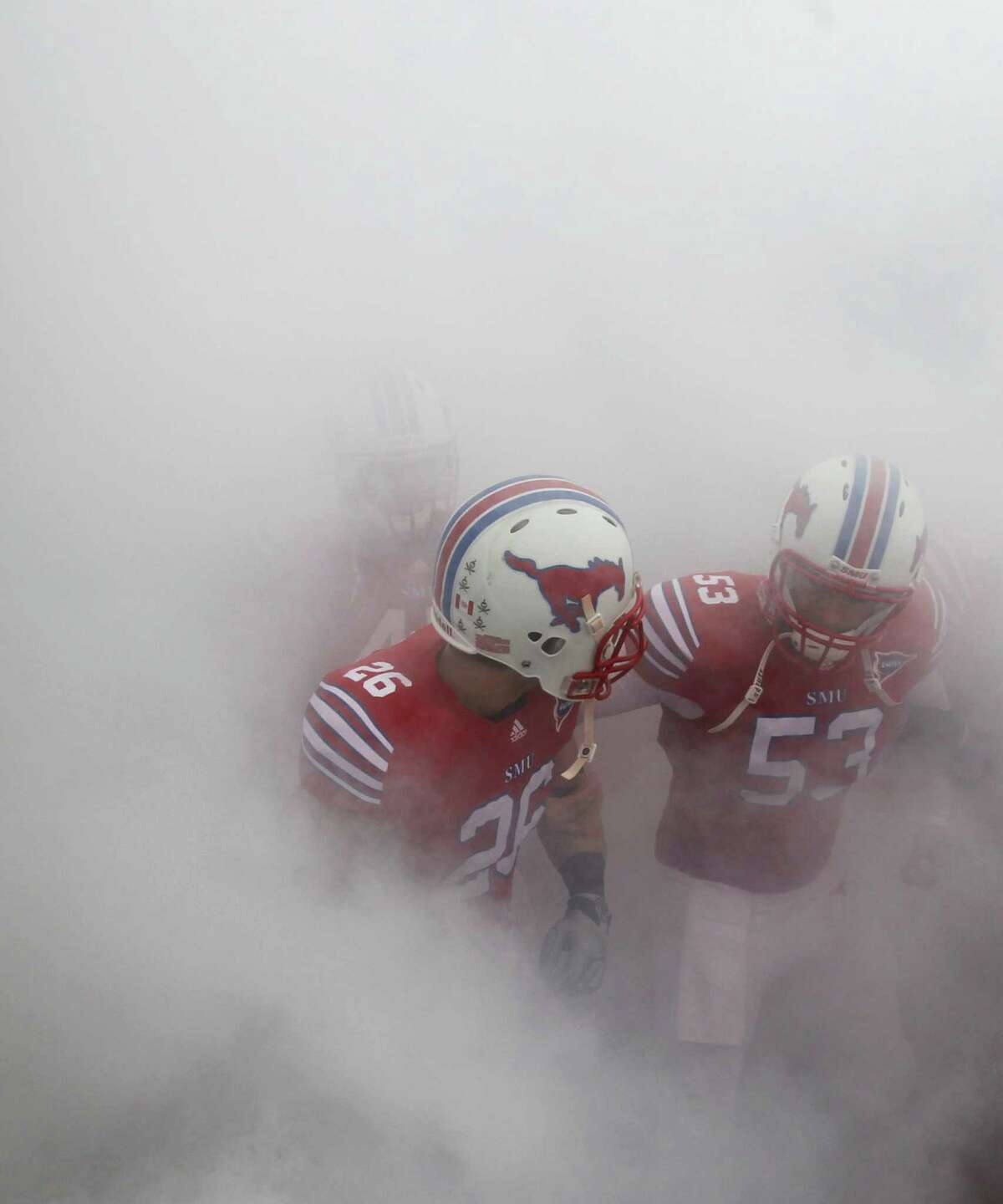 Hawaii Bowl, Dec. 24, SMU vs. Fresno State: SMU senior deep snapper Mark Voosen (53) is from New Braunfels Canyon.Caption: MU DB Brett Haness (26) and DS Mark Voosen (53) wait in the smoke to take the field before the SMU Mustangs vs. the Rice Owls college football game at Gerald J. Ford Stadium in Dallas on Saturday, November 26, 2011. (Louis DeLuca/The Dallas Morning News)
