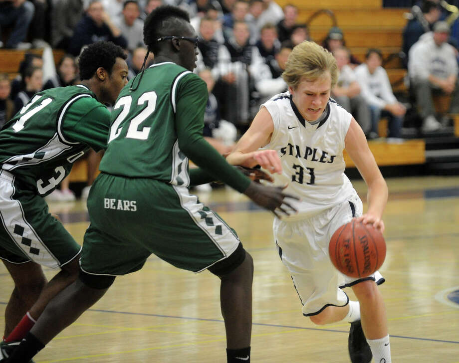 Highlights from boys basketball action between Staples and Norwalk at Staples in Westport, Conn. on Wednesday December 14, 2011. Staples' #31 Pete Rankowitz drives the ball. Photo: Christian Abraham / Connecticut Post