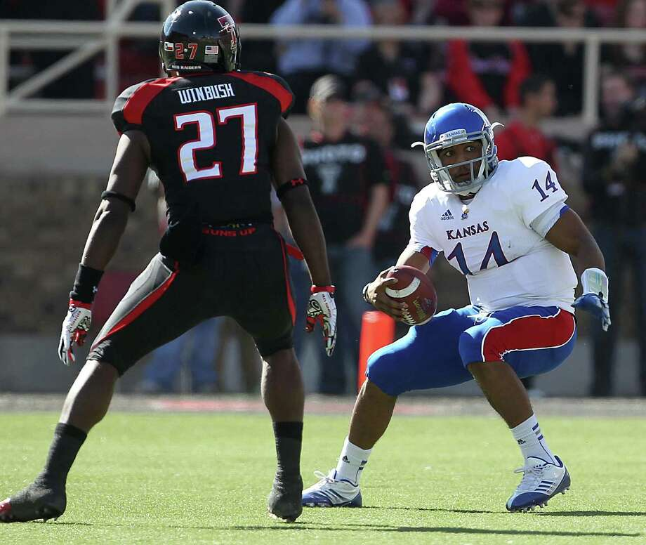 Meineke Car Care Bowl, Dec. 28, Texas Tech vs. Minnesota: Tech sophomore linebacker Zach Winbush (27) is from Clemens.Caption: Kansas' Michael Cummings, right, tries to get past Texas Tech's Zach Winbush during their NCAA college football game in Lubbock, Texas, Saturday, Nov. 10, 2012. (AP Photo/Lubbock Avalanche-Journal, Zach Long) LOCAL TV OUT Photo: Zach Long, Associated Press / Lubbock Avalanche-Journal