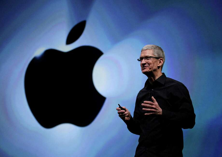 FILE - In this Wednesday, Sept. 12, 2012, file photo, Apple CEO Tim Cook speaks following an introduction of the new iPhone 5 in San Francisco. Apple is emerging as a gentler, cuddlier corporate citizen in the year after the death of CEO and co-founder Steve Jobs. CEO Tim Cook's announcement that the company is moving a Mac production line to the U.S. is just the latest step in a charm offensive designed to soften Apple's image. (AP Photo/Eric Risberg) Photo: Eric Risberg, Associated Press / AP