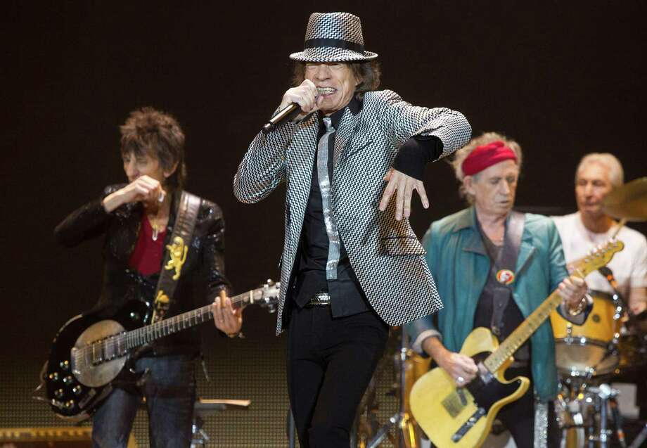 FILE - In this Nov. 25, 2012 file photo, Mick Jagger, center, Keith Richards, Ronnie Wood, left, and Charlie Watts, right, of The Rolling Stones perform at the O2 arena in east London. The Rolling Stones have been added to the list of artists performing at the 12-12-12 Hurricane Sandy benefit concert next week in New York City. Producers of the show said Friday, Dec. 7, 2012, had already raised $30 million that will be distributed to storm victims through the Robin Hood Foundation. The show is sold out. (Photo by Joel Ryan/Invision/AP) Photo: Joel Ryan