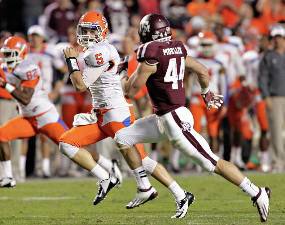 COLLEGE STATION, TX - NOVEMBER 17: Chris Grett #5 of the Sam Houston State Bearkats looks back as Sam Moeller #44 of the Texas A&M Aggies runs him down at Kyle Field on November 17, 2012 in College Station, Texas. Photo: Bob Levey, Getty Images / 2012 Getty Images