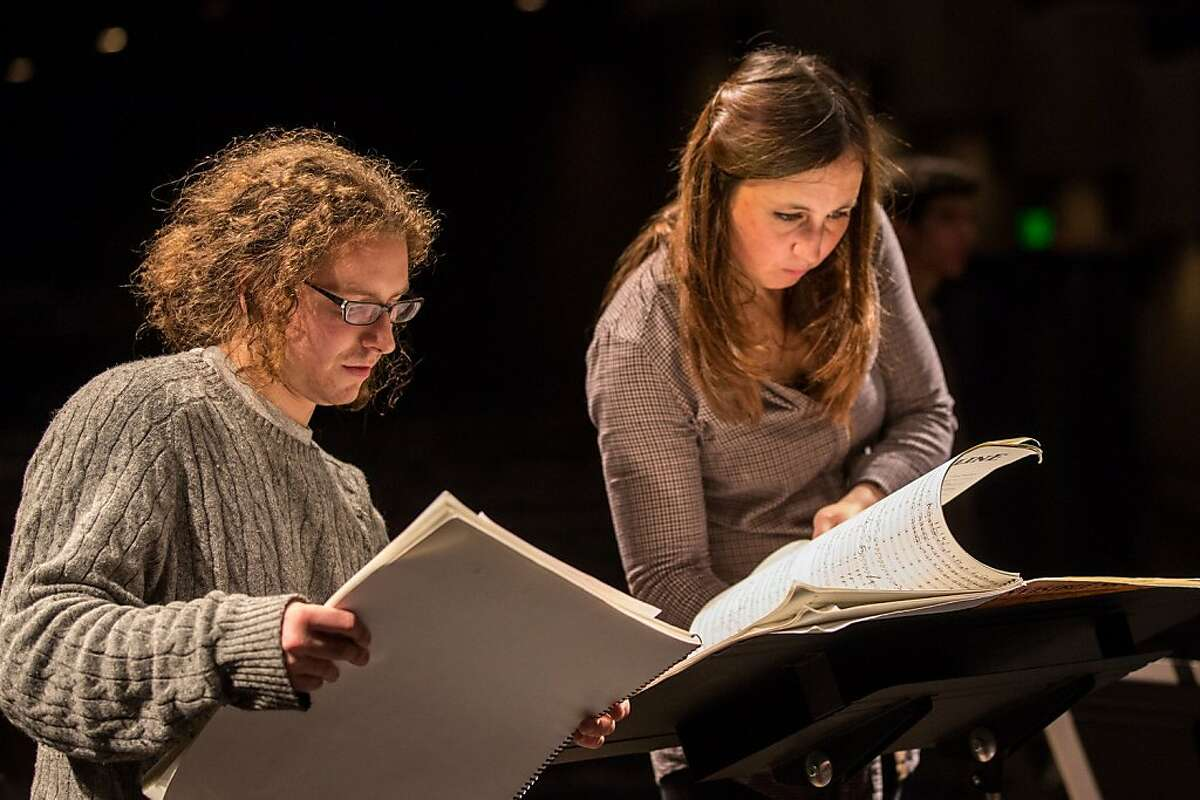 """Composer Dylan Mattingly (l.) with conductor Joana Carneiro in rehearsal for the premiere of his """"Invisible Skyline"""" with the Berkeley Symphony"""