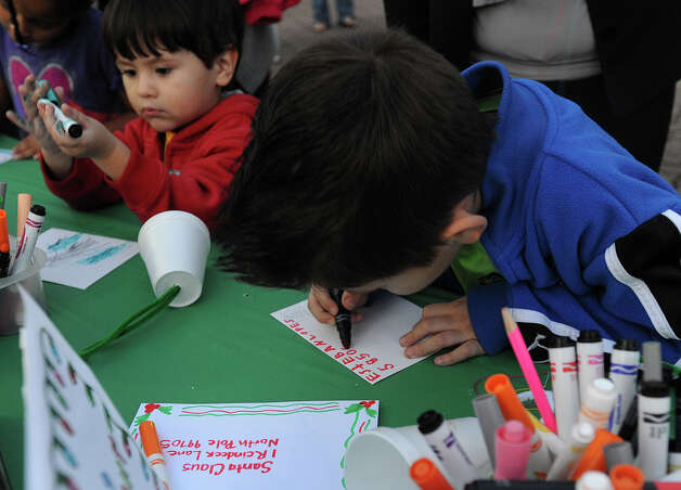Antonio Lopez, left and Esteban Lopez, make a wish list to be mailed to Santa during a Christmas event at the Art Museum of Southeast Texas on Thursday.  Photo taken Thursday, December 06, 2012 Guiseppe Barranco/The Enterprise Photo: Guiseppe Barranco, STAFF PHOTOGRAPHER / The Beaumont Enterprise