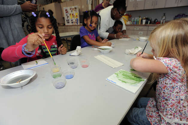 Children create tile art during a Christmas event at the Art Museum of Southeast Texas on Thursday. The tiles will be part of the Rotary Centennial Park. Photo taken Thursday, December 06, 2012 Guiseppe Barranco/The Enterprise Photo: Guiseppe Barranco, STAFF PHOTOGRAPHER / The Beaumont Enterprise