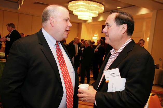 Bill Keneally, left, speaks with Tom Baldwin during Connecticut Association for Corporate Growth's 9th Annual Private Equity Exposition at the Stamford Marriott Friday, Dec. 7, 2012. Photo: DAVID AMES / GREENWICH TIME FREELANCE