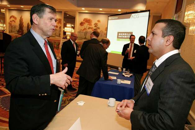 Zubin Avari, right, of Charter Oak Equity, LP speaks with Doug Traver at the Connecticut Association for Corporate Growth's 9th Annual Private Equity Exposition at the Stamford Marriott Friday, Dec. 7, 2012. Photo: DAVID AMES / GREENWICH TIME FREELANCE
