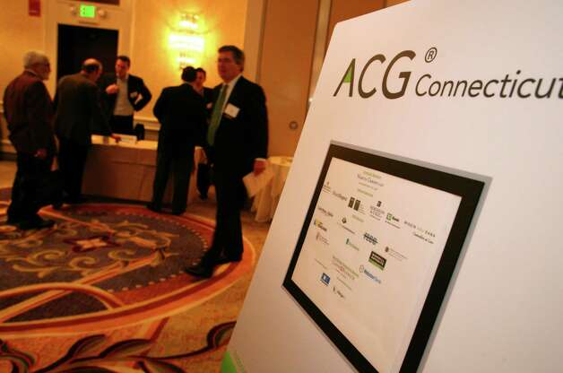 The Connecticut Association for Corporate Growth held their 9th Annual Private Equity Exposition at the Stamford Marriott Friday, Dec. 7, 2012. Photo: DAVID AMES / GREENWICH TIME FREELANCE
