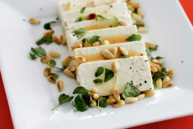 In this undated image, feta cheese and honey are shown served on a platter in Concord, N.H. (AP Photo/Matthew Mead) Photo: Matthew Mead, FRE / FR170582