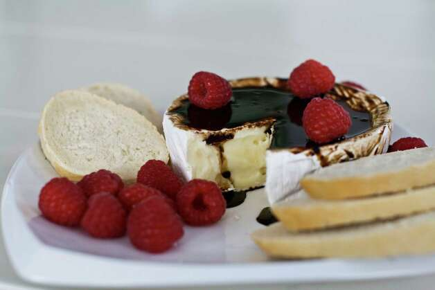 In this image taken on Monday, November 26, 2012, brie with bourbon-balsamic glaze is shown on a platter in Concord, N.H. (AP Photo/Matthew Mead) Photo: Matthew Mead, FRE / FR170582