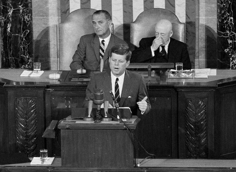 In this May 25, 1961 file photo, President John F. Kennedy speaks in the House of Representatives before a joint session of Congress in Washington. In the background are Vice President Lyndon B. Johnson, left, and House Speaker Sam Rayburn. During that speech, Kennedy issued the challenge for NASA to send a man to the moon. That challenge that was met on July 20, 1969, when Apollo 11's lunar module landed on the moon. (AP)