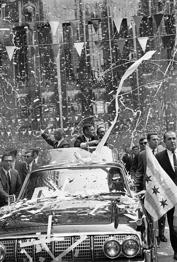 Ticker tape, tissue and confetti greet Apollo 11 astronauts on Chicago?s LaSalle Street, August 13, 1969. From left, Edwin Aldrin, Neil Armstrong, first man on the moon, and Michael Collins. (AP Photo) (ASSOCIATED PRESS)