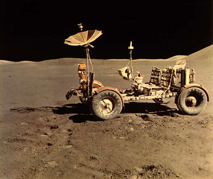 Apollo 15 Lunar Rover alone, looking north, the west edge of Mount Hadley is at upper right edge of