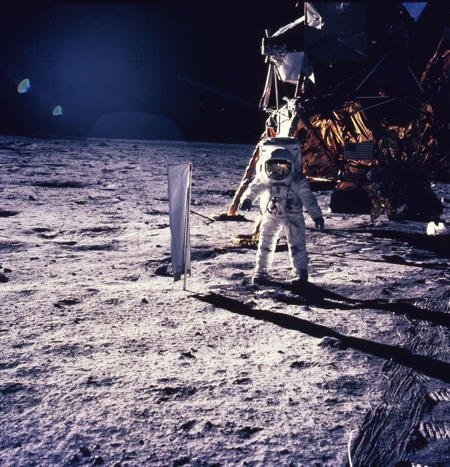 Astronaut Edwin E. Aldrin Jr. walks on the surface of the moon, July 30, 1969, with seismogaphic equipment which he just set up. The flag like object on a pole is a solar wind experiment and in the background is the Lunar Landing Module. (AP Photo/NASA/Neil Armstrong) (AP Photo/NASA/Neil Armstrong) (AP)