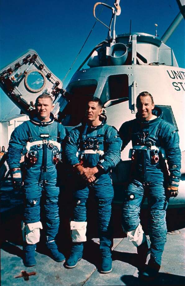 A December 1968 file photo picture shows the Apollo 8 crew, from left: commander Frank Borman, command module pilot James A. Lovell, Jr., and lunar module pilot William A. Anders. Dec. 21, 2008 sees the 40th anniversary of the launch of the Apollo 8 mission bringing Mission Commander Frank Borman, Command Module Pilot James Lovell and Lunar Module Pilot William Anders as the first humans ever to another celestial body. The mission during which the Apollo 8 crew became the first humans to see the far side of the Moon, paved the way for later missions including Apollo 11 to land the first man on the Moon in 1969.  (AP Photo/Stf, File) (ASSOCIATED PRESS)