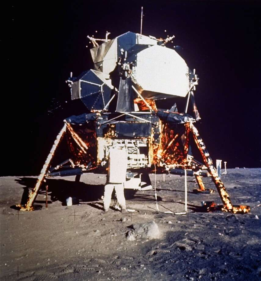 Astronaut Edwin E. Aldrin Jr., lunar module pilot, prepares to deploy the Early Apollo Scientific Experiments Package (EASEP) during Apollo 11 lunar surface extravehicular activity, July 20, 1969.  Astronaut Neil A. Armstrong, commander, took this photograph with a 70 mm lunar surface camera.  Aldrin is removing the EASEP from its stowed position. (AP Photo/NASA/Neil A. Armstrong) (AP)