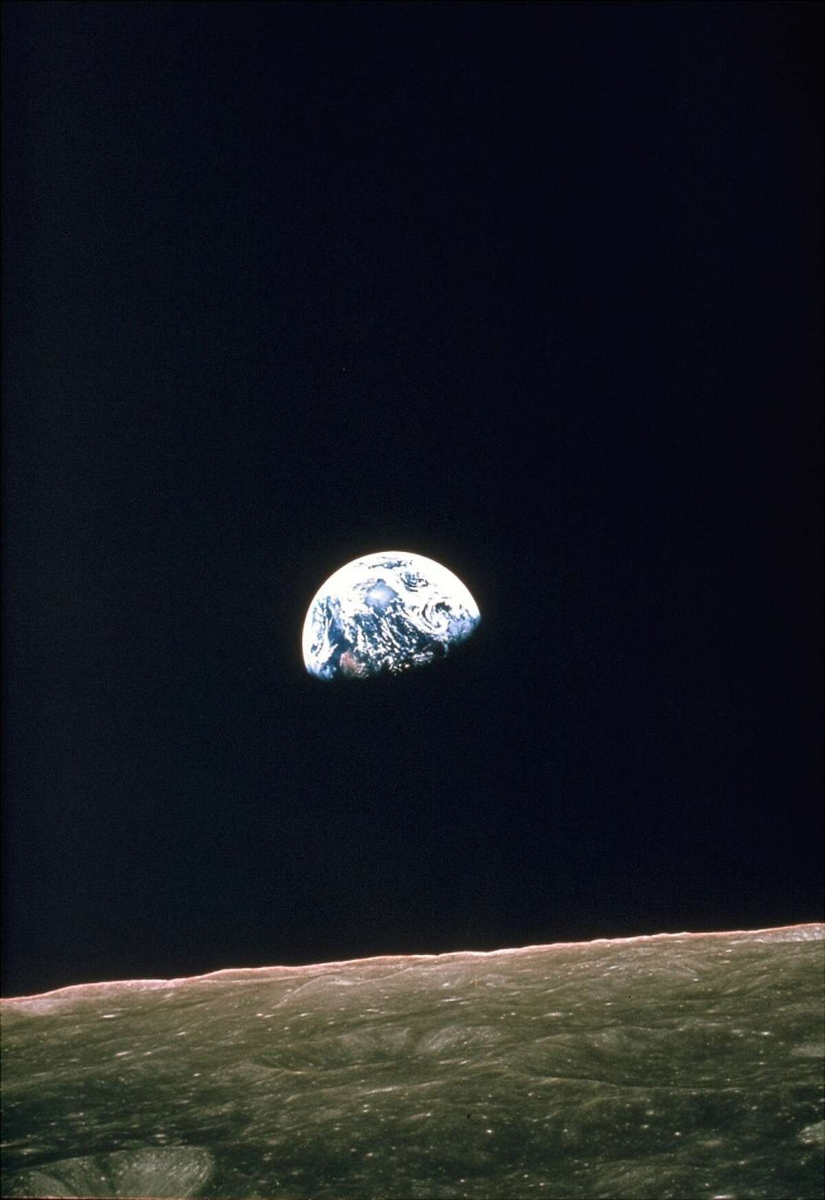 This photo, released by NASA on Dec. 29, 1968, shows the view of the rising Earth that greeted Apollo 8 astronauts as they came from behind the moon after the lunar orbit insertion burn. The Earth is about five degrees above the horizon in this photo. The unnamed surface features in the foreground are near the eastern limb of the moon as viewed from Earth. Dec. 21, 2008 sees the 40th anniversary of the launch of the Apollo 8 mission bringing Mission Commander Frank Borman, Command Module Pilot James Lovell and Lunar Module Pilot William Anders as the first humans ever to another celestial body. The mission during which the Apollo 8 crew became the first humans to see the far side of the Moon, paved the way for later missions including Apollo 11 to land the first man on the Moon in 1969. (AP photo/Nasa, File) (ASSOCIATED PRESS)