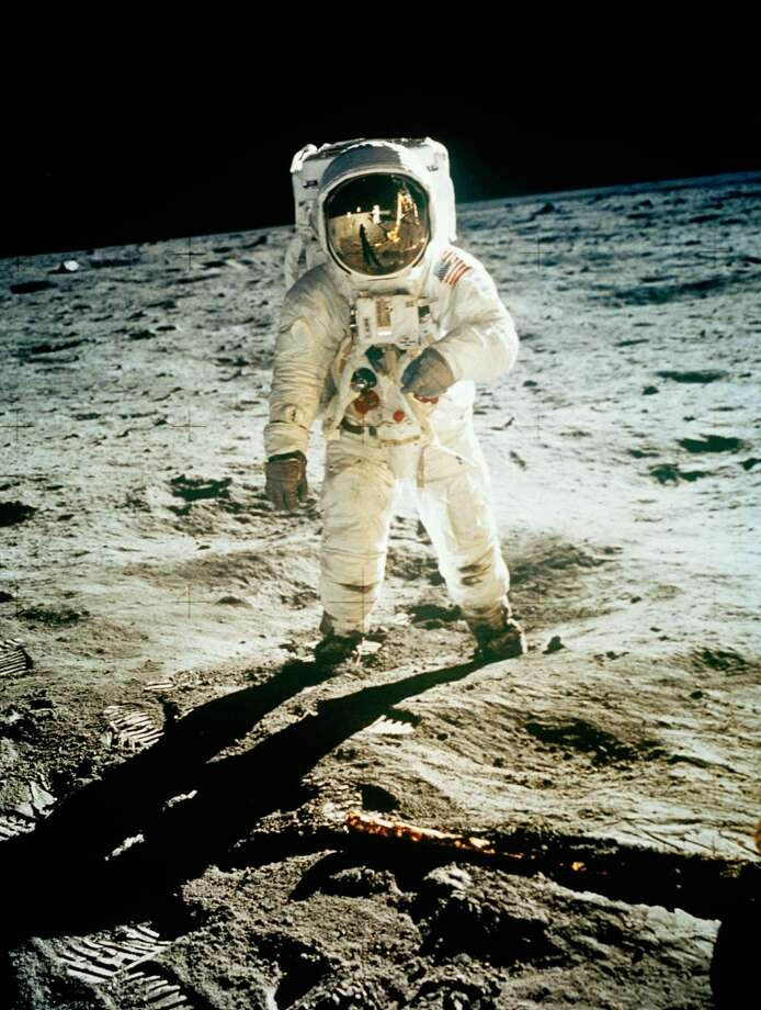 In this July 20, 1969 file photo from NASA,  Astronaut Edwin E. Aldrin Jr., lunar module pilot, is photographed by Neil Armstrong walking near the lunar module during the Apollo 11 extravehicular activity. (AP Photo, NASA ,file) (ASSOCIATED PRESS)