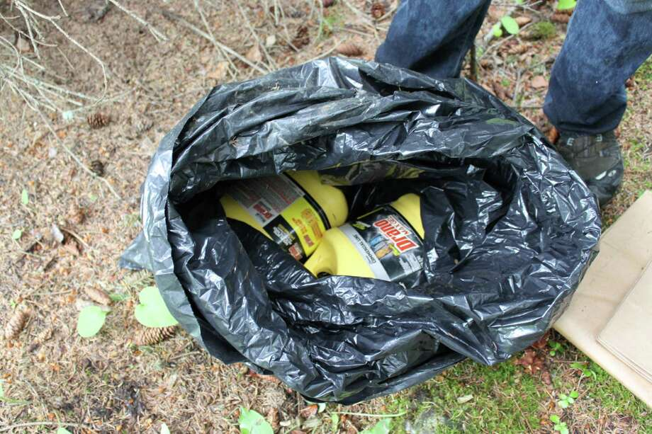This undated photo provided by the FBI shows bottles of Drano found inside a plastic bag in Eagle River, Alaska, just north of Anchorage. The FBI says confessed Alaska serial killer Israel Keyes, who targeted people across the country, told authorities he planned to strike again in the state if he had gotten away with the murder of an 18-year-old Anchorage barista. (AP Photo/FBI) Photo: HOPD / FBI