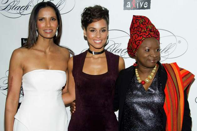 Padma Lakshmi, left, Alicia Keys, center, and Angelique Kidjo attend the Keep a Child Alive's ninth annual Black Ball on Thursday, Dec. 6, 2012 in New York. (Photo by Charles Sykes/Invision/AP) Photo: Charles Sykes