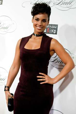 Alicia Keys attends the Keep a Child Alive's ninth annual Black Ball on Thursday, Dec. 6, 2012 in New York. (Photo by Charles Sykes/Invision/AP) Photo: Charles Sykes