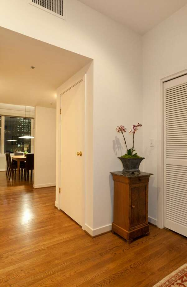 Entry of 1009 Western Ave., No. 1209. The 2,024-square-foot home,  built in 1983, has two bedrooms, each with its own bathroom, a powder room, a den, 10-foot ceilings, two balconies and views of downtown, Elliot Bay and the Olympic Mountains. It's listed for $1.1 million. Photo: Courtesy Penny Lewis/Windermere Real Estate