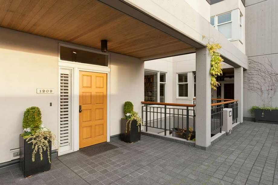 Front door of 1009 Western Ave., No. 1209. The 2,024-square-foot home,  built in 1983, has two bedrooms, each with its own bathroom, a powder room, a den, 10-foot ceilings, two balconies and views of downtown, Elliot Bay and the Olympic Mountains. It's listed for $1.1 million. Photo: Courtesy Penny Lewis/Windermere Real Estate