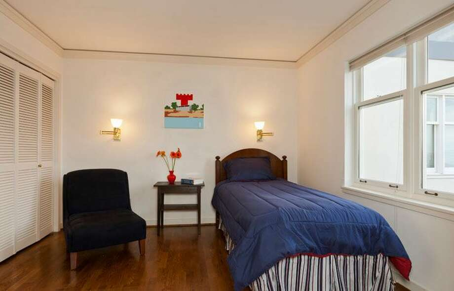 Second bedroom of 1009 Western Ave., No. 1209. The 2,024-square-foot home,  built in 1983, has two bedrooms, each with its own bathroom, a powder room, a den, 10-foot ceilings, two balconies and views of downtown, Elliot Bay and the Olympic Mountains. It's listed for $1.1 million. Photo: Courtesy Penny Lewis/Windermere Real Estate