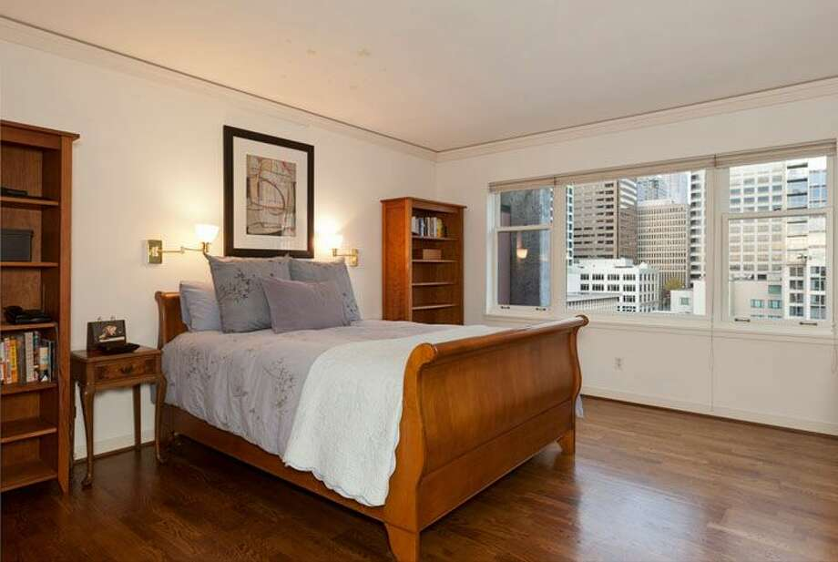 Master bedroom of 1009 Western Ave., No. 1209. The 2,024-square-foot home,  built in 1983, has two bedrooms, each with its own bathroom, a powder room, a den, 10-foot ceilings, two balconies and views of downtown, Elliot Bay and the Olympic Mountains. It's listed for $1.1 million. Photo: Courtesy Penny Lewis/Windermere Real Estate