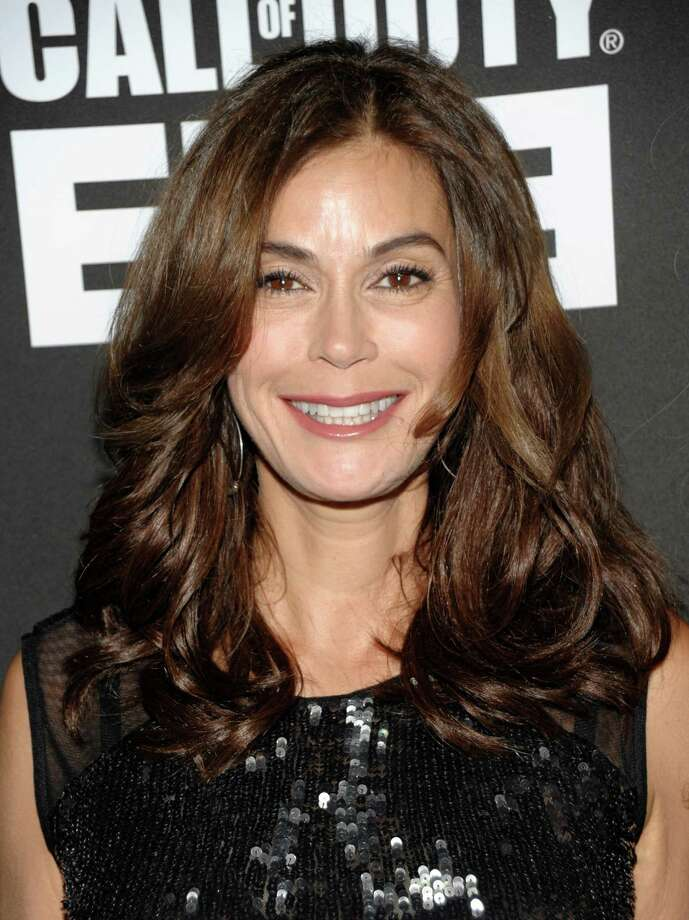 Actress Teri Hatcher arrives at the Call of Duty: Modern Warfare 3 launch party in Los Angeles on Saturday, Sept. 3, 2011. (AP Photo/Dan Steinberg) Photo: DAN STEINBERG / R-STEINBERG