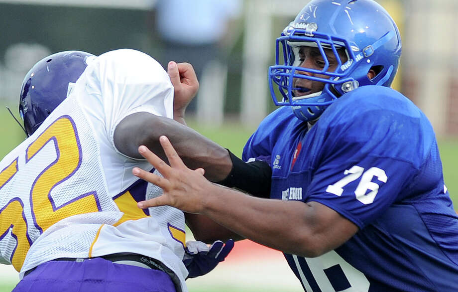 "West Brook's nose guard, Ja'Ron Greene, drives through Lufkin's offense during a scrimmage at the Carrol A. ""Butch"" Thomas Educational Support Center on Friday. Photo taken Friday, August 24, 2012  Guiseppe Barranco/The Enterprise Photo: Guiseppe Barranco, STAFF PHOTOGRAPHER / The Beaumont Enterprise"