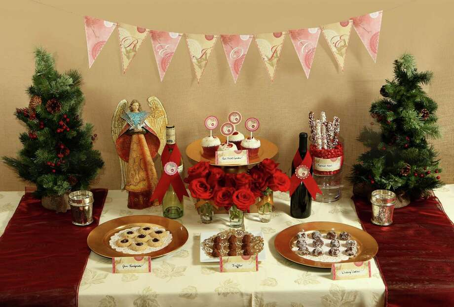 Start your party with a suite of printable decorations. Express-News features producer Imelda Robles created two designs that can be downloaded at MySA.com. Photo: Helen L. Montoya, San Antonio Express-News / ©SAN ANTONIO EXPRESS-NEWS