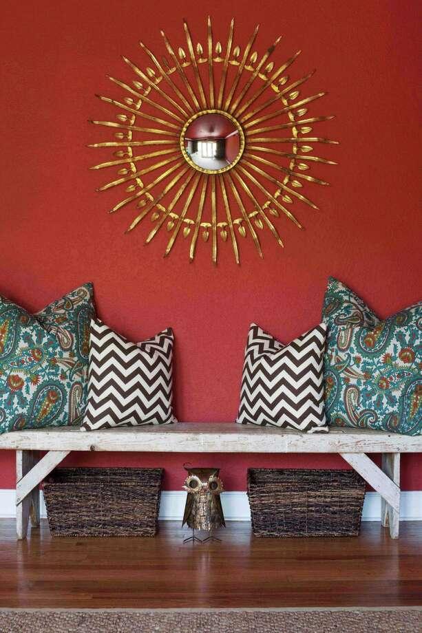 Designer Brian Patrick Flynn often incorporates benches. They can  serve as decoration most of the time but be pulled out to accommodate guests. Photo: Associated Press / Brian Patrick Flynn